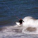 Strapless kite surfing in warm waves and water