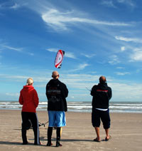 Introduction to kiteboarding lesson on the beach with IKO certified Level 2 senior instructor and two students