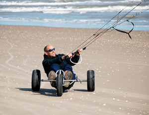 kite buggy and training kite on beach