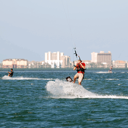Intermediate kiter riding downwind in South Padre Island
